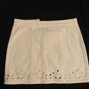 White jean skirt with shaped cut outs